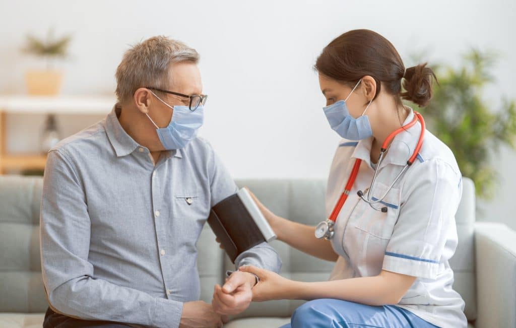 A Photo of a JRMC Family Medical and Dental Center Nurse measuring blood pressure